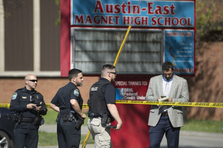 An armed student was shot by a police officer, and a Tennessee school officer was wounded