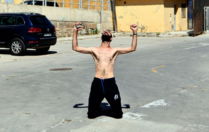 A man tightens his fists after entering Spain while swimming.