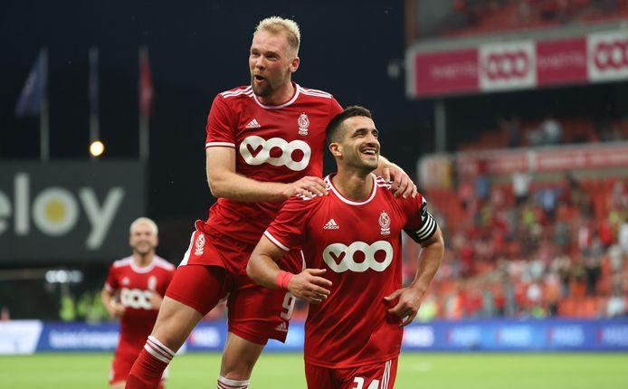 Klaus and Leavis celebrate 1-0.