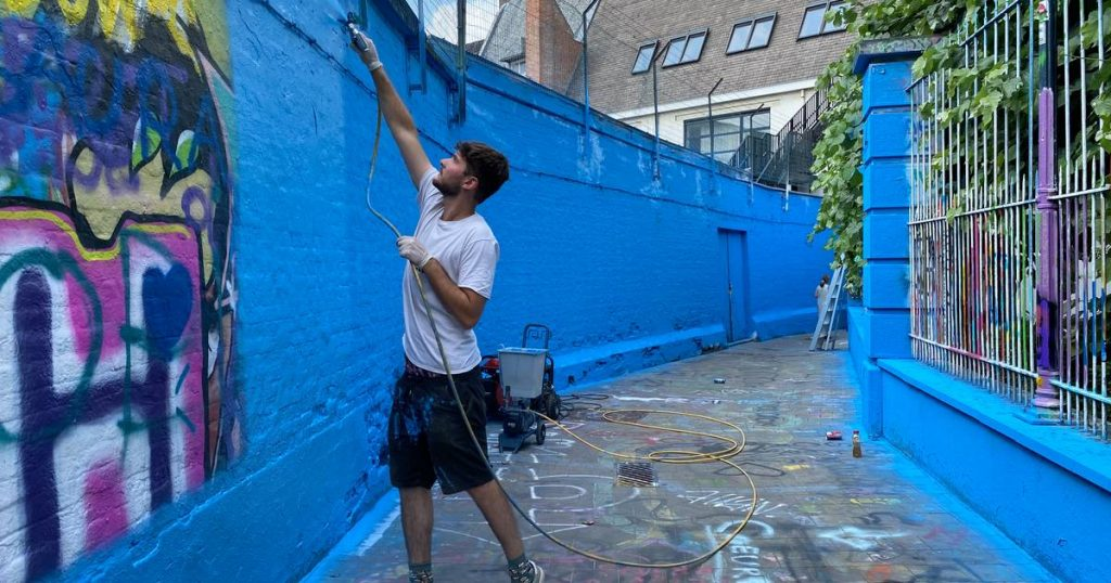 """Graffiti Street is all painted blue: """"Just as a reminder that this is a public space and no one can claim a piece of the wall""""    Ghent"""