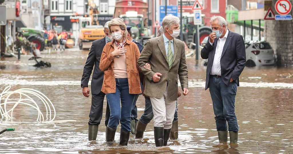 King Philip and Mathilde wear boots in the water to show support for flood victims |  severe weather