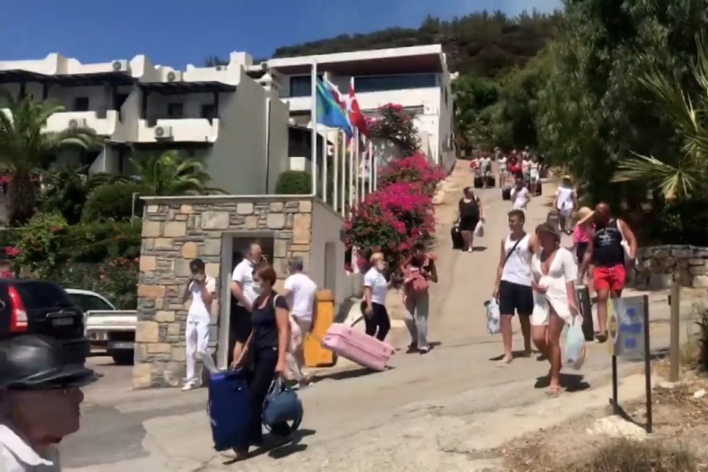 Tourists have to pack their bags due to the wildfires, which are part of...