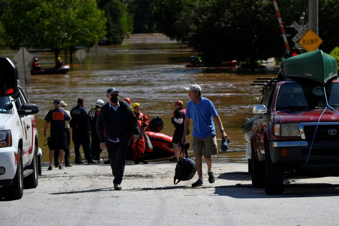 Rescue workers rescue people trapped by flooding in the aftermath of Tropical Storm Ida in Conshohocken, Pennsylvania.