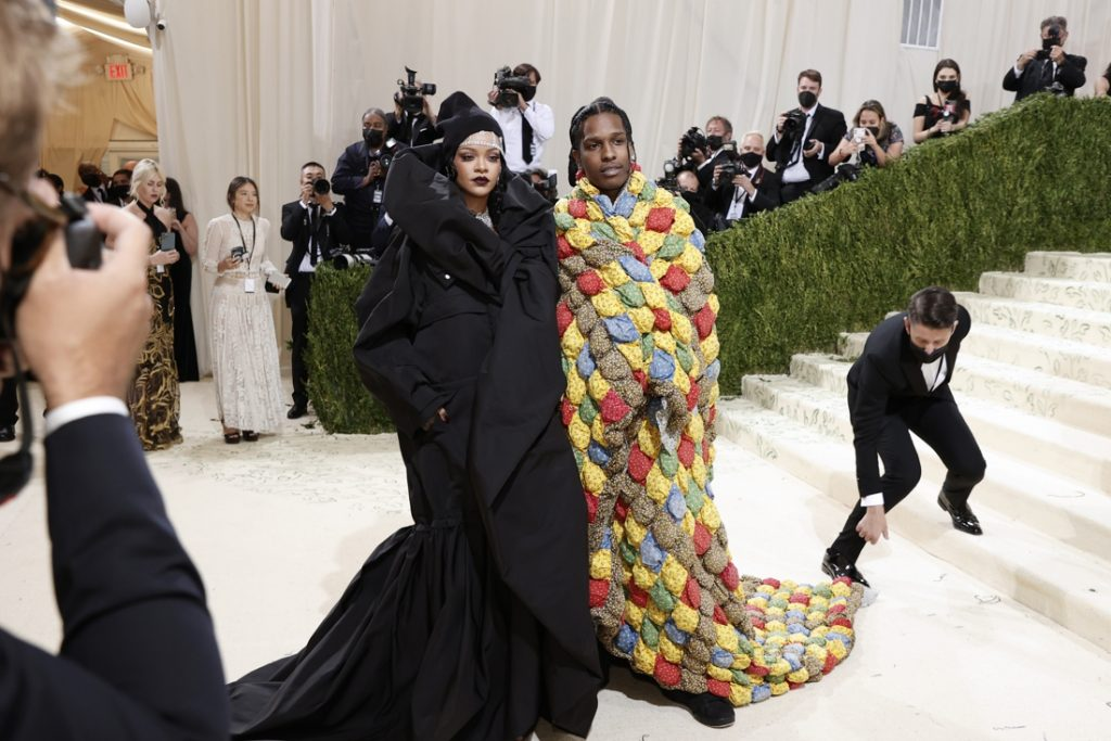 Is it a bed sheet or an iconic costume?  The woman recognizes the paper...