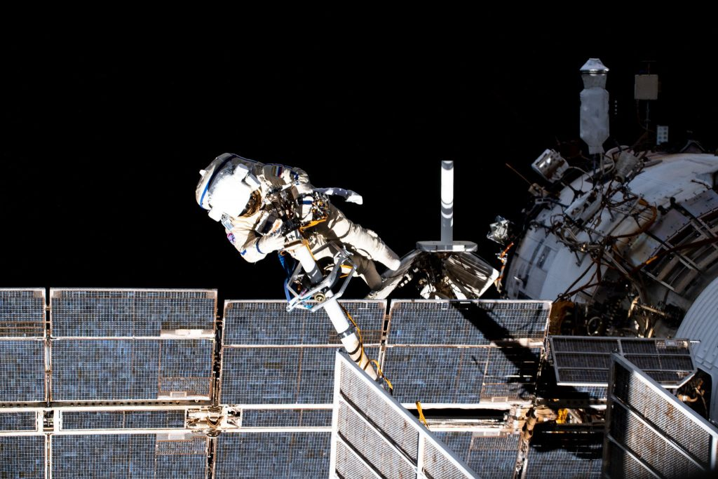 Watch two Russian cosmonauts walk in space outside the International Space Station